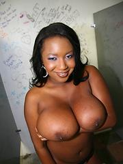 Huge boob black beauty sucks cock in the gloryhole