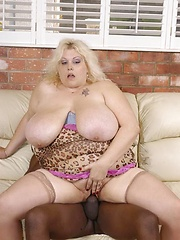Large, lusty lady sucks a big black cock!
