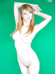 A sexy photo shoot with big tits Japanese babe, Tia