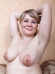 Evlalia strips naked on her lonely sofa