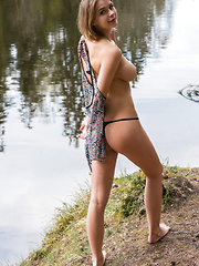 Yelena strips by the river baring her curvy hips and big tits.