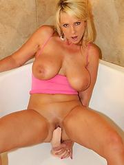 Naughty Alysha fucking her toys in the bathtub