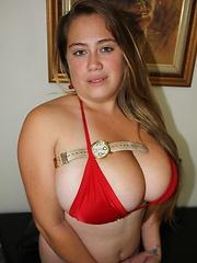 Silvia Calibresa posing giant tits in red bikini.