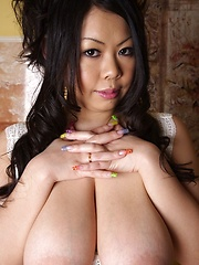 Big breasted japanese with colored big nails posing