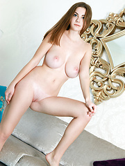 Marta E enjoys a cup of coffee before she start stripping on the sofa