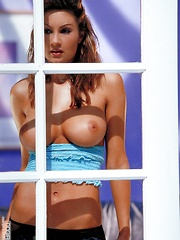 Amy Ried - Hottie in the window in blue tubtop and blue jeans