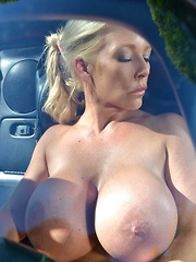 Airbags On The Hood: Busty Blonde's Big Tits Exposed!