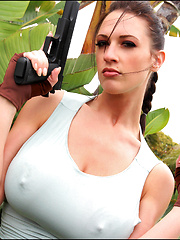 Busty Lana Kendrick gets in costume as Lara Croft to celebrate Halloween