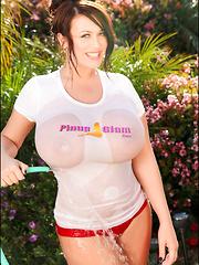 Super busty Leanne gets her huge boobs wet outside