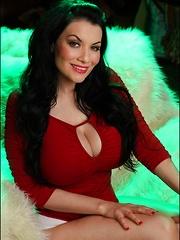 Dahlia Dark in red heels and green lighting