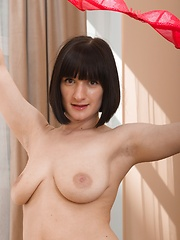 Alina H puts on sexy strip show on her sofa