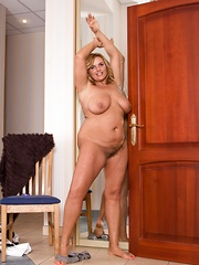 Lariona poses naked and strips in front of mirror