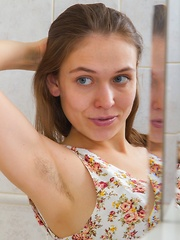 Agneta strips and wets up her body in the shower