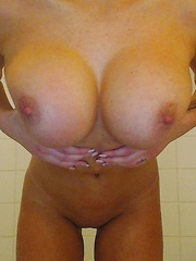 xoGisele gets wet and wild while she strips in the shower out of her white tee